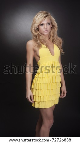 Beautiful blond woman wearing yellow dress