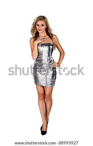 beautiful blond woman with beautiful body and long hair standing in silver short mini dress on white background - stock photo
