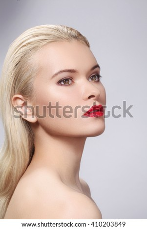 Beautiful blond woman with bright make-up. Sexy look with clean skin and red lips makeup  - stock photo