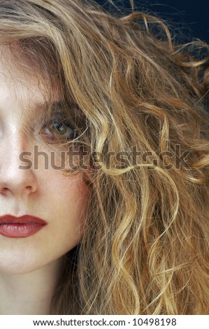 beautiful blond woman with curly hairstyle - stock photo