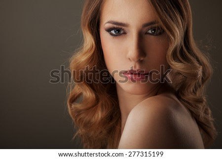 Beautiful Blond Woman with curly long hair  - stock photo