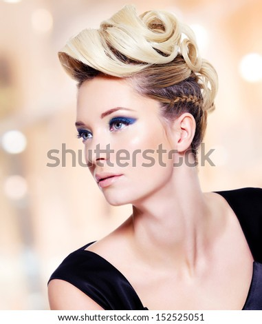 Beautiful blond woman with fashion  hairstyle and blue eye makeup  - stock photo