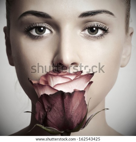 beautiful blond woman with flower.girl and rose.close-up portrait.most beautiful photo.skin care.make-up - stock photo