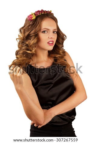 Beautiful blond woman with flower rim and curly hair - stock photo
