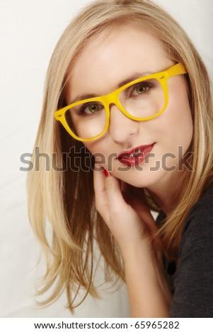 beautiful blond woman with geek yellow glasses. - stock photo
