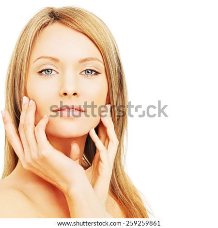 Beautiful blond woman with  healthy skin and hair - stock photo