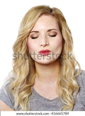 Beautiful blond woman with kissing lips. Positive Emotions. Young woman with copy space, isolated on white background. - stock photo