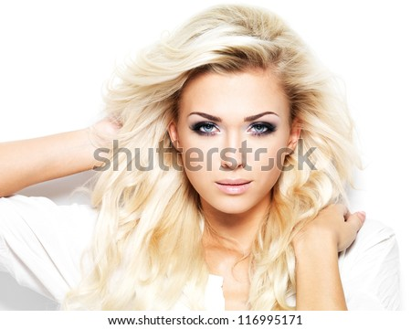 Beautiful blond woman with long curly hair - isolated on white - stock photo