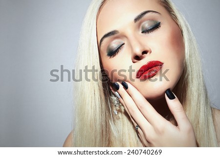 Beautiful blond Woman with make-up. Sexy Beauty Girl with red lips. Nail design Beauty salon. Shellac manicure
