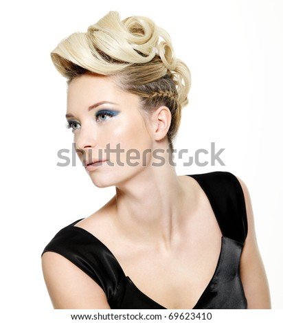 Beautiful blond woman with modern hairstyle and blue make-up of eyes - isolated on white background - stock photo