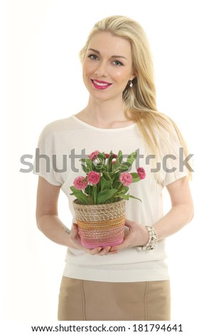 beautiful blond young model girl with pot of flowers  isolated on white studio photo