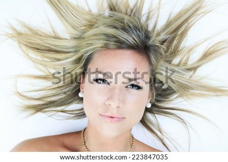 Beautiful blond young woman - stock photo