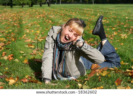 beautiful blond  young woman in autumn park - stock photo