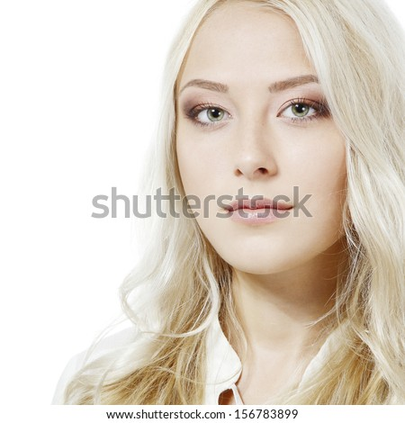 Beautiful blond young woman looking at camera. Isolated on white background - stock photo