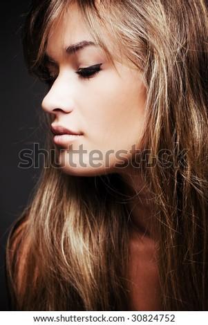 beautiful blond young woman profile - stock photo