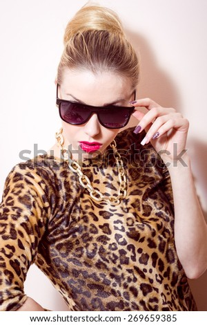 Beautiful blond young woman with sunglasses on white background, portrait - stock photo