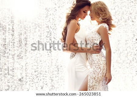 Beautiful blonde and brunette angels - stock photo