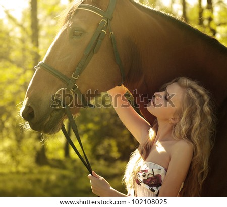 beautiful blonde and horse - stock photo