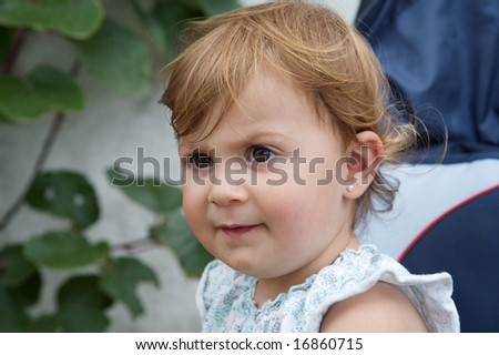 Beautiful blonde baby girl with blurred background