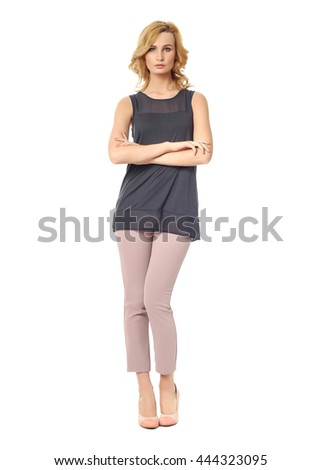 Beautiful blonde business woman posing on isolated white background - stock photo