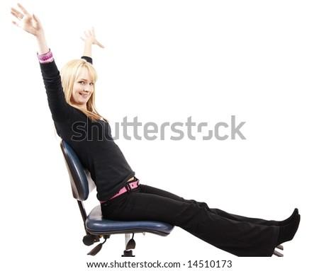 Beautiful blonde businesswoman having fun while sitting. Isolated on white background - stock photo