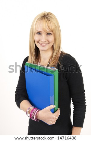 Beautiful blonde businesswoman holding blue and green files. Isolated on a white background