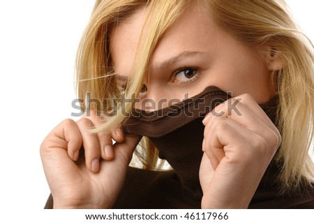Beautiful blonde cover her face with collar, isolated over white - stock photo