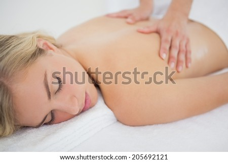 Beautiful blonde enjoying a massage at the health spa