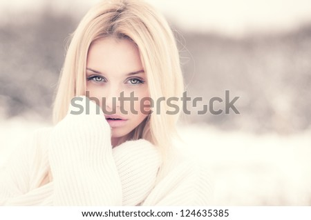 beautiful blonde freezing outdoors in winter - stock photo