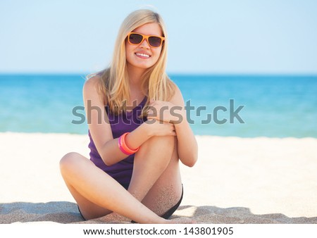 Beautiful blonde girl at the beach. - stock photo