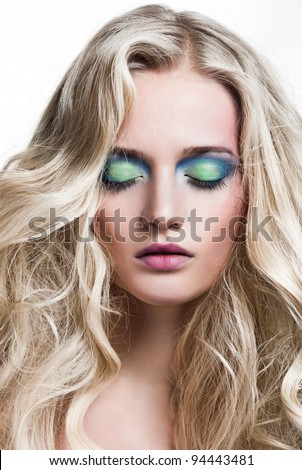 Beautiful Blonde Girl. Healthy Long Curly Hair. - stock photo