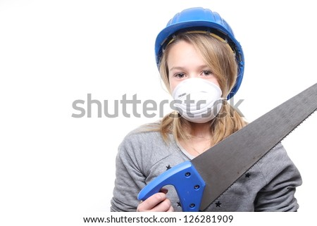Beautiful blonde girl holding a saw