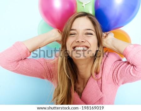 Beautiful blonde girl holding balloons - stock photo