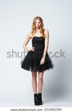 beautiful blonde girl in dress studio shot - stock photo