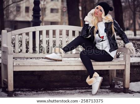 Beautiful blonde girl in posing outdoors - stock photo