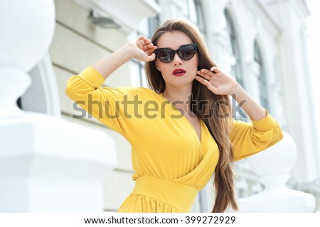 Beautiful blonde girl in sunglasses  - stock photo