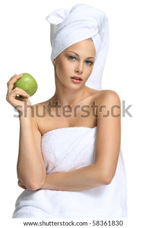 Beautiful blonde girl in towel and fresh apple spa - stock photo