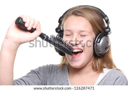 Beautiful blonde girl listening to music