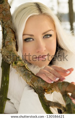 beautiful blonde girl of about tree in winter - stock photo