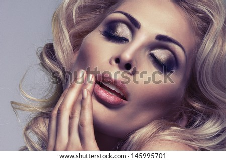 Beautiful Blonde Girl. Perfect Makeup.Make-up. Close-up Portrait - stock photo