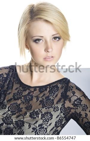 Beautiful blonde girl posing in grey dress - stock photo