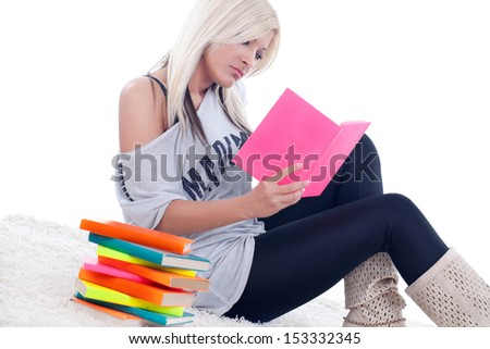 beautiful blonde girl reading a  book