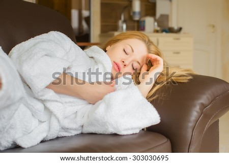 Beautiful blonde Girl sleeping on the chair