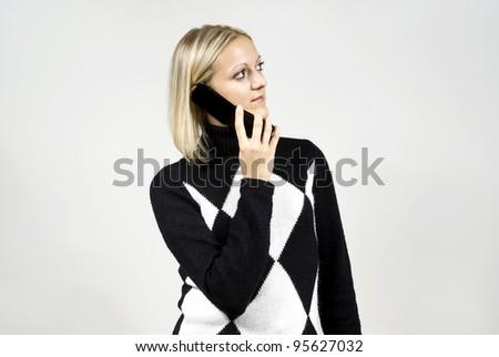 Beautiful blonde girl talking on the phone - stock photo