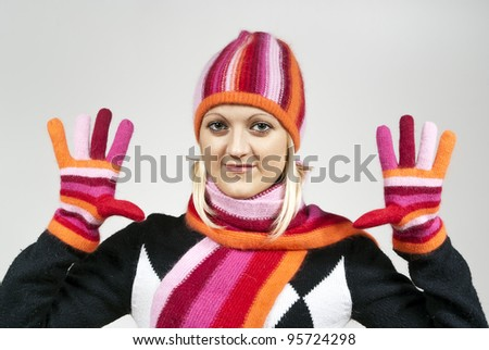 Beautiful blonde girl wearing a hat and gloves on the background - stock photo