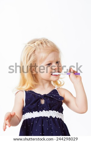 Beautiful blonde haired girl with toothbrush in her hand on whit - stock photo