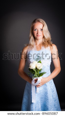 Beautiful blonde haired woman in blue bridal dress