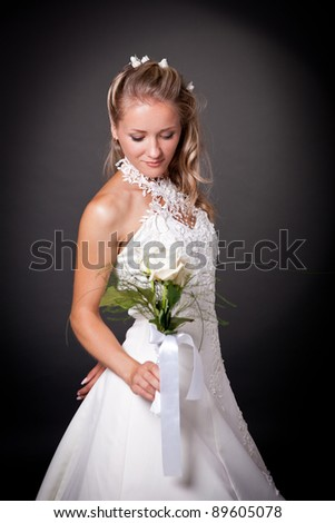 Beautiful blonde haired woman in white bridal dress