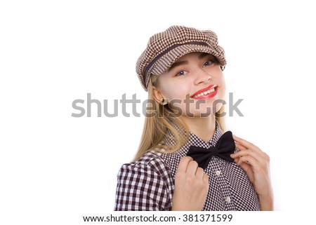 beautiful blonde in a checkered cap on white background