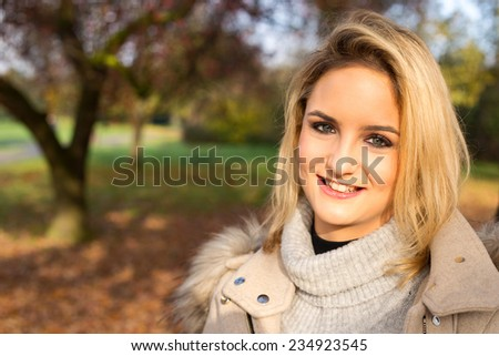 beautiful blonde in a park. - stock photo